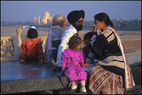 Indian family, Agra Fort with Taj Mahal in the background